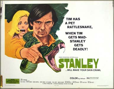 This image shows the US half-sheet film poster for the 1972 film <i>Stanley</i> starring Chris Robinson; the poster shows Robinson as protagonist Tim Ochopee holding out his rattlesnake named Stanley, mouth open and fangs protruding. The tagline is