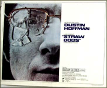 The image shows the US half-sheet promotional poster for the 1971 Sam Peckinpah film <i>Straw Dogs</i> starring Dustin Hoffman, featuring the key art close-up of Dustin Hoffman's face with broken eyeglasses.
