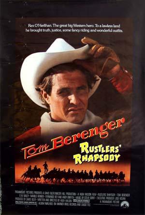 The image shows the US one-sheet promotional poster for the 1985 Hugh Wilson film <i>Rustler's Rhapsody</i>, starring Tom Berenger and Patrick Wayne.