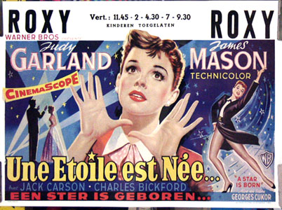 Pictured is a reprint of the Belgian promotional poster for the Georges Cucor film A Star is Born starring Judy Garland.