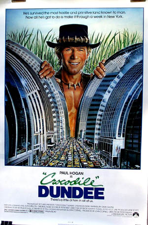 Pictured is a US promotional poster for the 1986 Paul Faiman film Crocodile Dundee starring Paul Hogan.