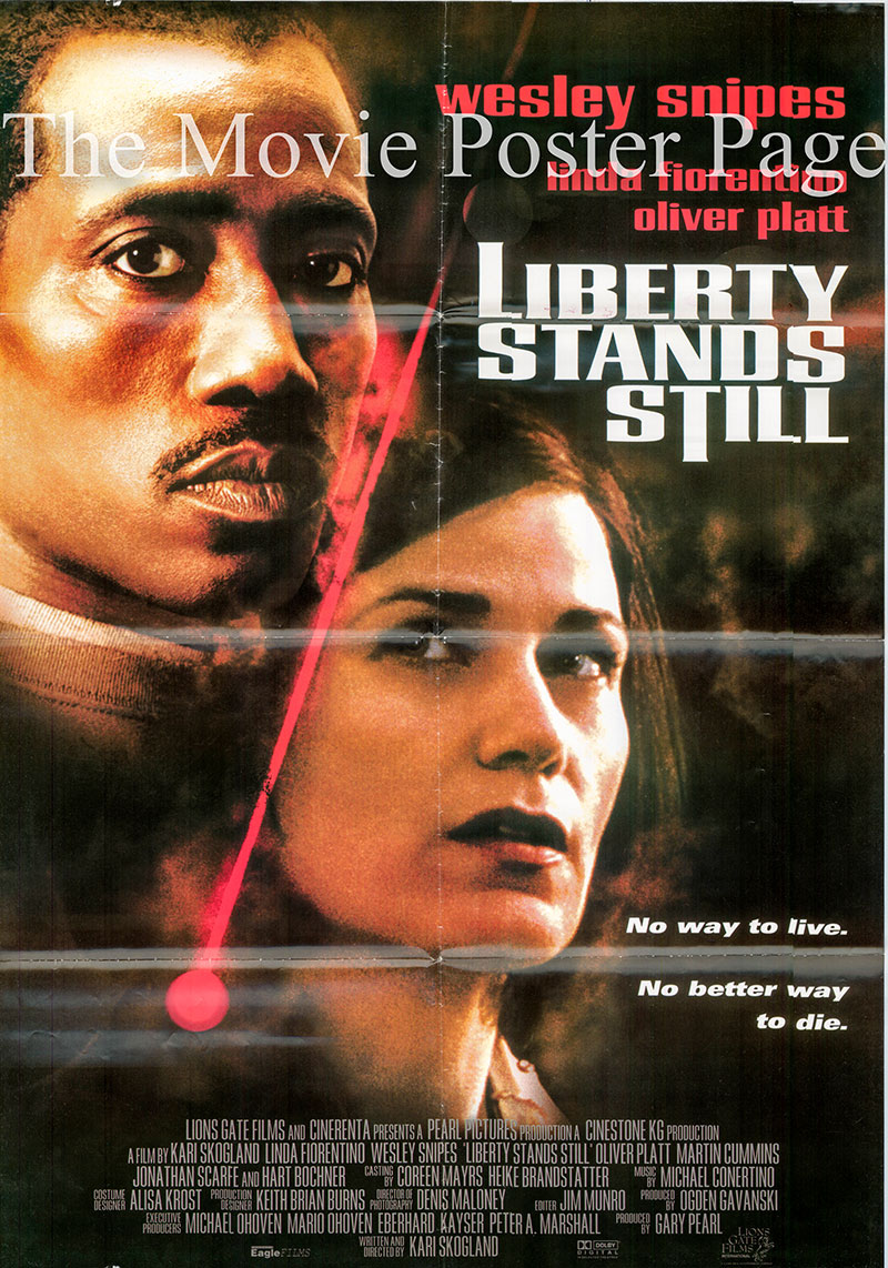 Pictured is a Lebanese promotional poster for the 2002 Kari Skogland film Liberty Stands Still starring Wesley Snipes and Linda Fiorentino.