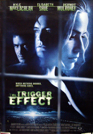 Pictured is a US one-sheet promotional poster for the 1996 David Koepp film The Trigger Effect starring Kyle MacLachlan.