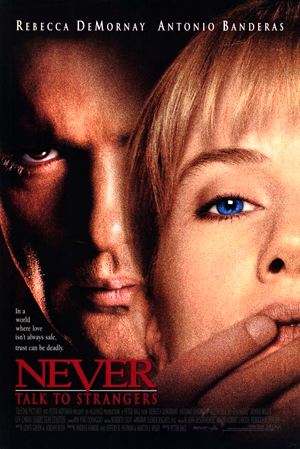 Pictured is a US one-sheet promotional poster for the 1995 Peter Hall film Never Talk to Strangers starring Antonio Banderas and Rebecca De Mornay.