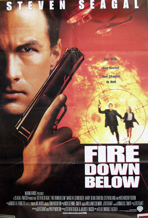 Pictured is a US one-sheet reprint promotional poster for the 1997 Felix Enriquez Alcala film Fire Down Below starring Steven Seagal.