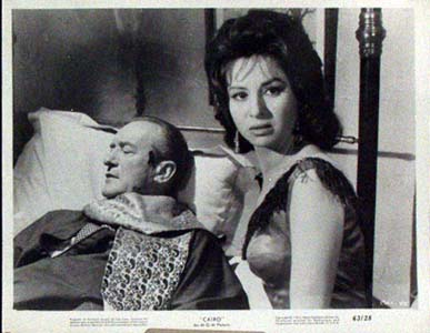 Pictured is a black and white still photo for the 1963 Wolf Rilla film Cairo starring George Sanders.