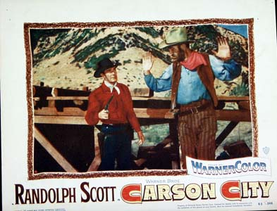 Pictured is a US lobby card for the 1954 Andre De Toth film Carson City starring Randolph Scott.