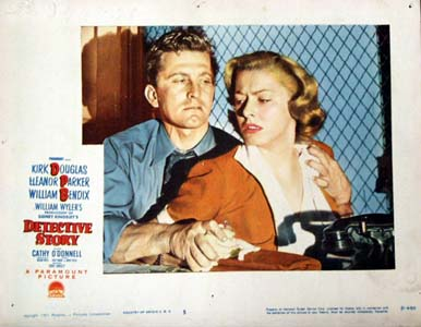 Pictured is a US lobby card for the 1951 William Wyler film Detective Story starring Kirk Douglas and Eleanor Parker.