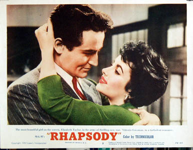 Pictured is a US lobby card for the 1954 Charles Vidor film Rhapsody starring Elizabeth Taylor and Vittorio Gassman.