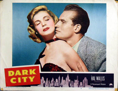 Pictured is a US lobby card for the 1950 William Dieterle film Dark City starring Charlton Heston and Lizbeth Scott.