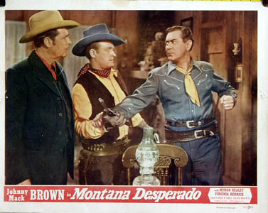 Pictured is a US lobby card for the 1951 Wallace Fox film starring Johnny Mack Brown.
