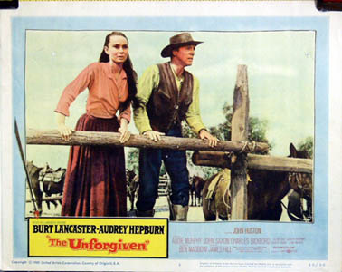 Pictured is a US lobby card for the 1960 John Huston film The Unforgiven starring Audrey Hepburn and Burt Lancaster.
