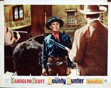 Pictured is a US lobby card for the 1954 Andre De Toth film The Bounty Hunter starring Randolph Scott.