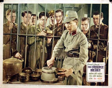 Pictured is a US lobby card for the 1944 Lewis Milestone film The Purple Heart starring Dana Andrews, Richard Conte and Farley Granger.