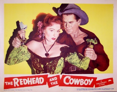 Pictured is a US promotional lobby card for the 1951 Leslie Fenton film The Redhead and the Cowboy starring Rhonda Fleming and Glenn Ford.