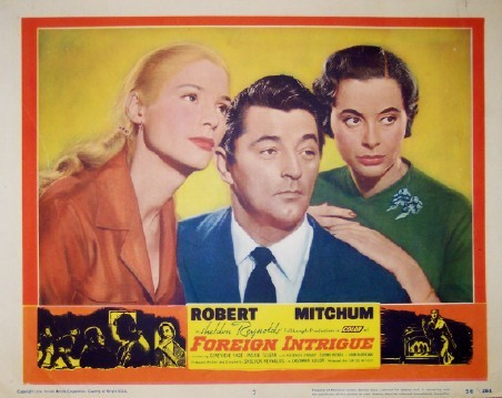 Pictured is a US lobby card for the 1956 Sheldon Reynolds film Foreign Intrigue starring Robert Mitchum.