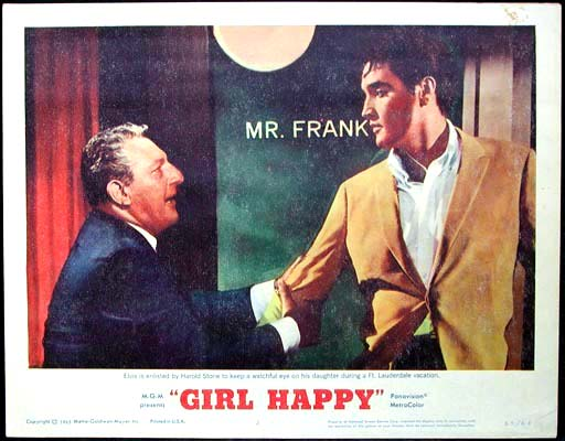 Pictured is a US promotional lobby card for the 1965 Boris Sagal film Girl Happy starring Elvis Presley.