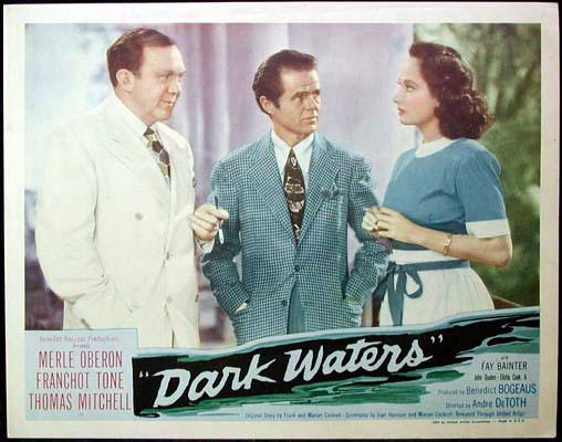 Pictured is a US lobby card for the 1944 Andre De Toth film Dark Waters starring Merle Oberon and Franchot Tone.