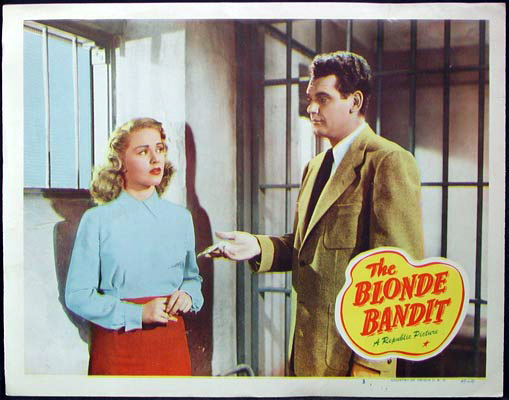 Pictured is a US lobby card for the 1950 Harry Keller film The Blonde Bandit starring Gerald Mohr and Dorothy Patrick.