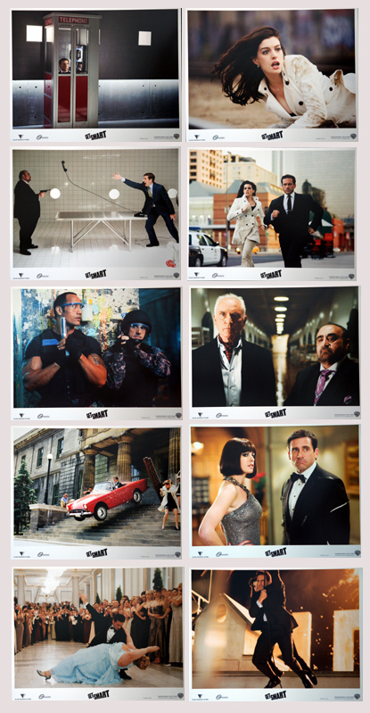 Pictured is a US lobby card set for the 2008 Peter Segal film Get Smart starring Steve Carell as Maxwell Smart and Anne Hathaway as Agent 99.