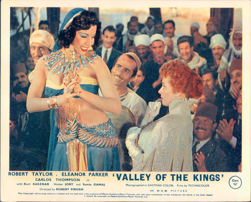 Pictured is a UK lobby card for the 1954 Robert Pirosh film Valley of the Kings starring Robert Taylor, featuring an image of Samia Gamal.