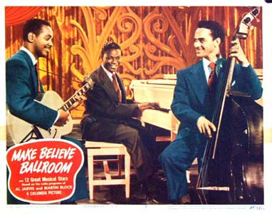 Pictured is a US lobby card for the 1949 Joseph Santley film Make Believe Ballroom with a photo of the Nat King Cole Trio.