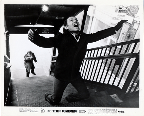 Pictured is an original promotional black-and-white still for the 1971 William Friedkin film The French Connection starring Gene Hackman.