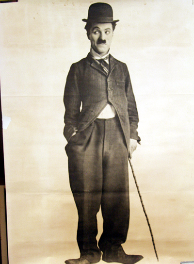 Pictured is a US commercial celebrity poster with a photo of Charlie Chaplin.