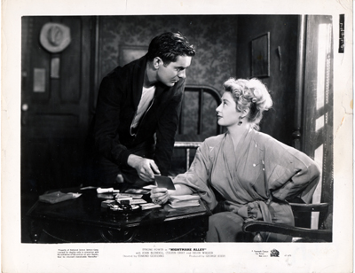 Pictured is a US promotional still photo from the 1947 Edmund Goulding film Nightmare Alley starring Tyrone Power.
