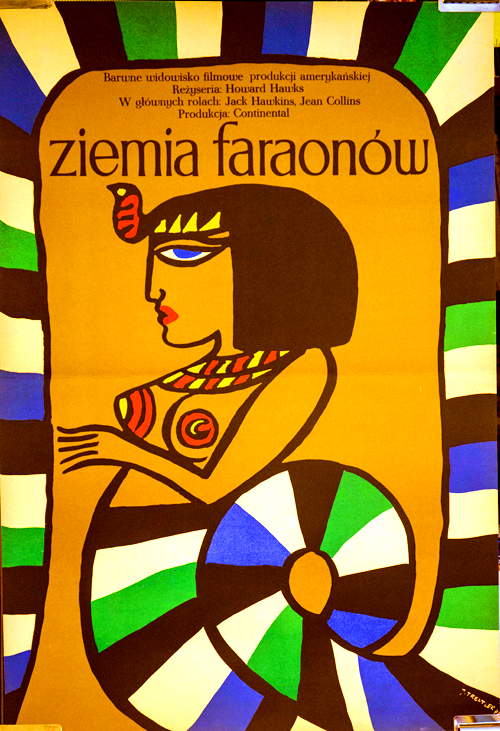 Pictured is a Polish one-sheet promotional poster for a 1972 rerelease of the 1955 Howard Hawks film Land of the Pharaohs, starring Jack Hawkins.
