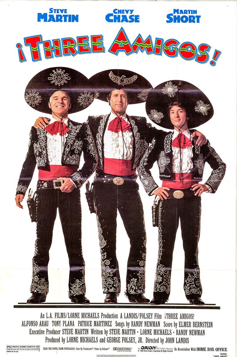 Pictured is a US one-sheet poster for the 1986 John Landis film Three Amigos starring Steve Martin as Lucky Day.