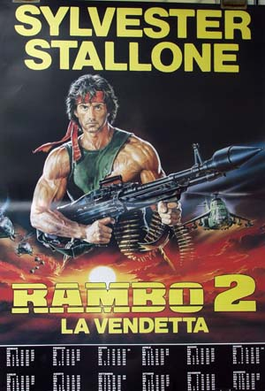 Pictured is a reprint of an Italian promotional poster for the 1985 George P. Cosmatos film Rambo 1st Blood II starring Sylvester Stallone.