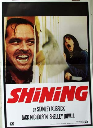 Pictured is an Italian repring of a promotional film poster for the 1980 Stanley Kubrick film The Shining starring Jack Nicholson and Shelley Duvall.