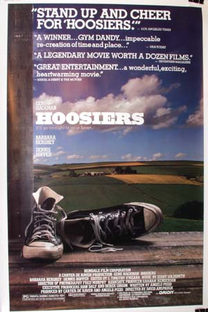 Pictured is a reprint of the US promotional poster for the 1986 David Anspaugh film Hoosiers starring Gene Hackman.