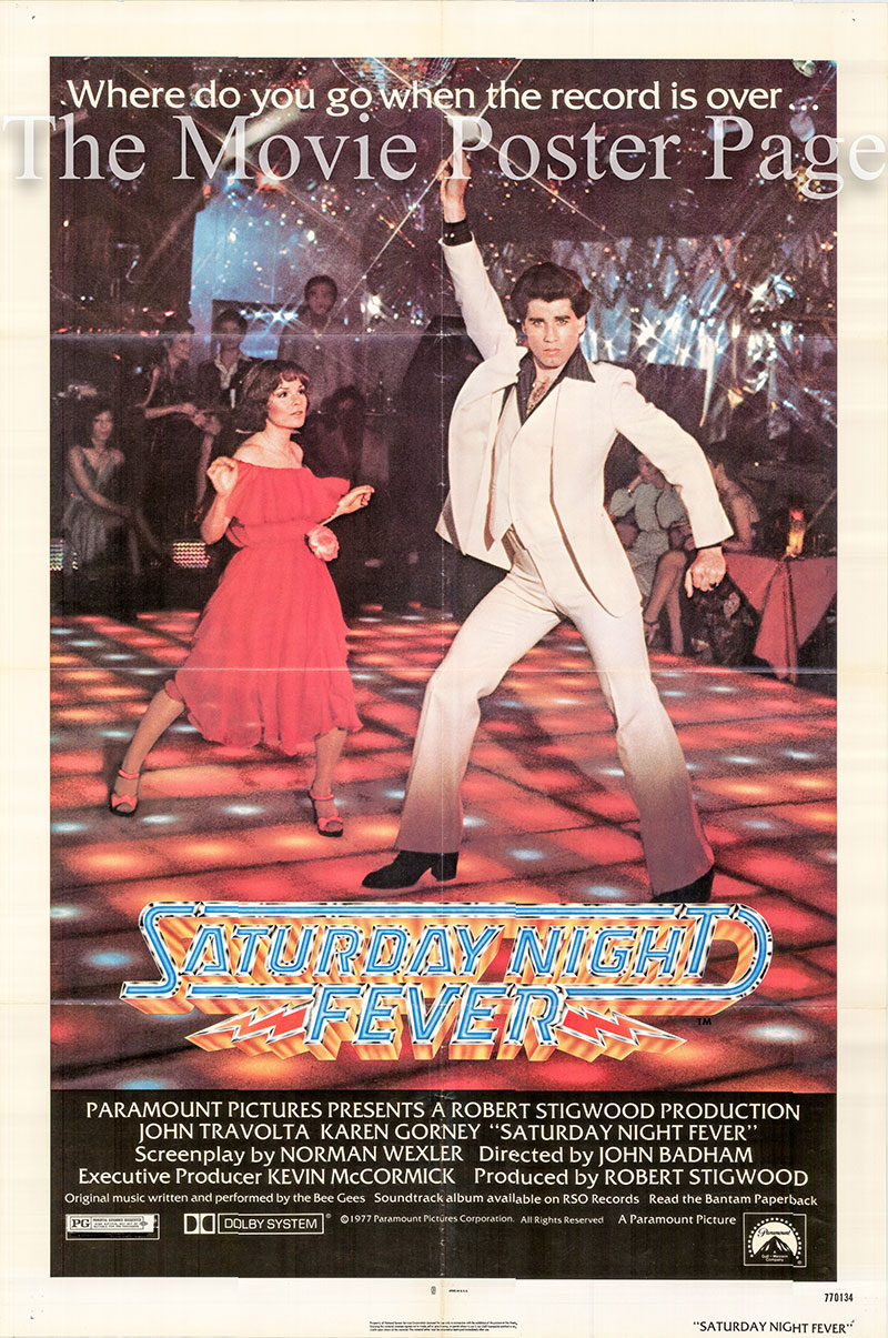 Pictured is a US one-sheet poster for the 1977 John Badham film Saturday Night Fever starring John Travolta as Tony Manero.