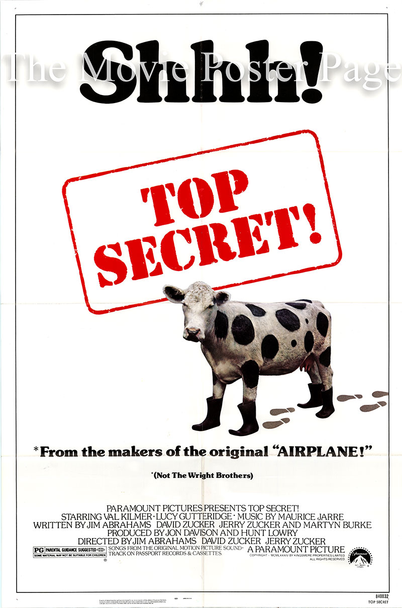 Pictured is a US one-sheet poster for the 1984 Jim Abrahams and David Zucker film Top Secret starring Val Kilmer as Nick Rivers.