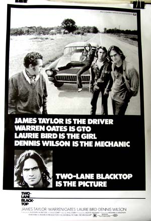 Pictured is a repinrt of a US promotional poster for the 1971 Monte Hellman film Two-Lane Blacktop starring James Taylor.