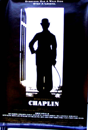 Pictured is a US promotional poster for the 1992 Richard Attenborough film Chaplin starring Robert Downey Jr.