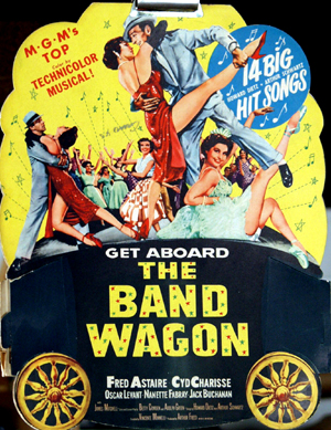 Pictured is a cardboard promotional standee for the 1953 Vincente Minnelli film The Band Wagon starring Fred Astaire.