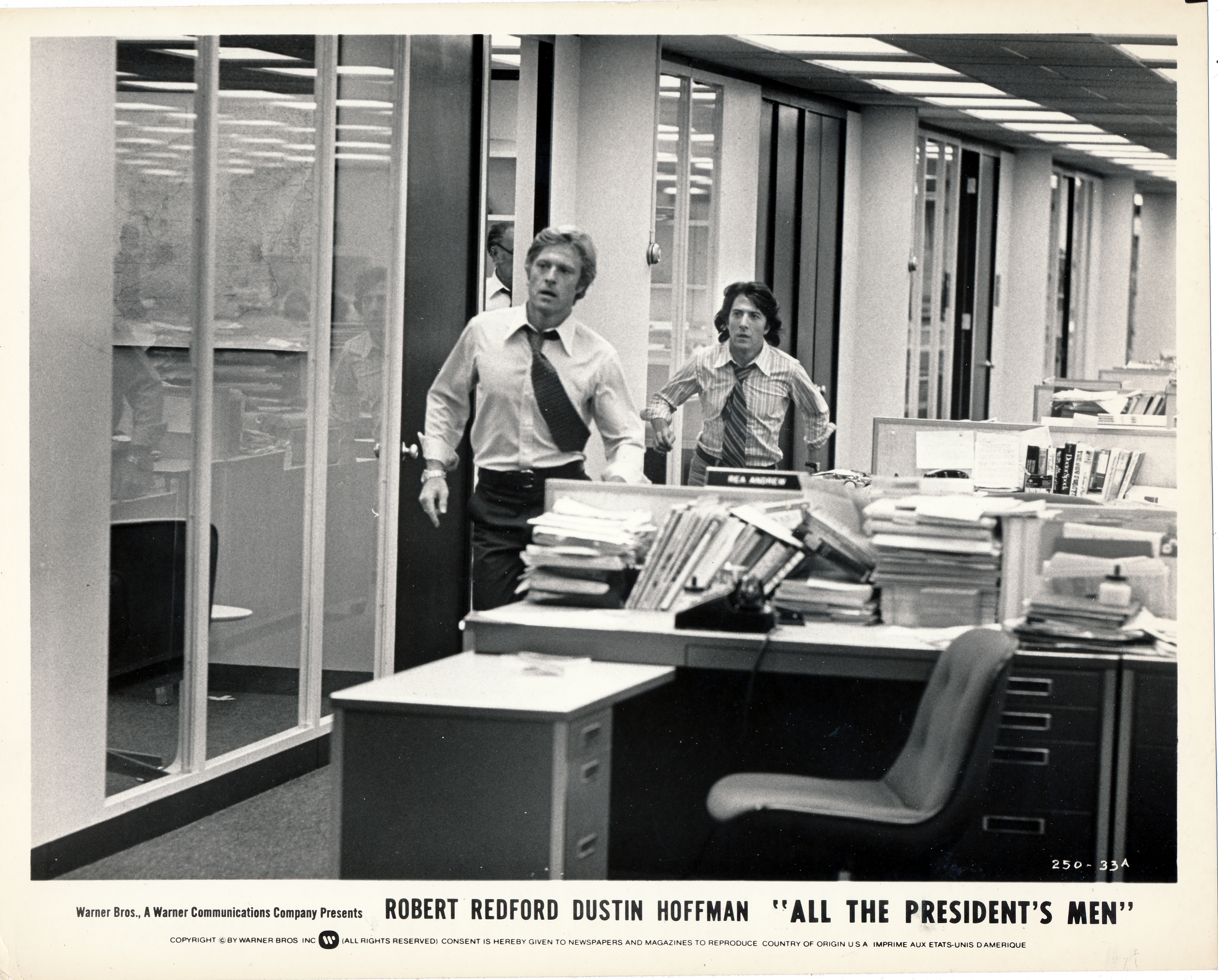 Pictured is a US black-and-white stile for the 1976 Alan J. Pakula film All the President's Men starring Robert Redford and Dustin Hoffman.