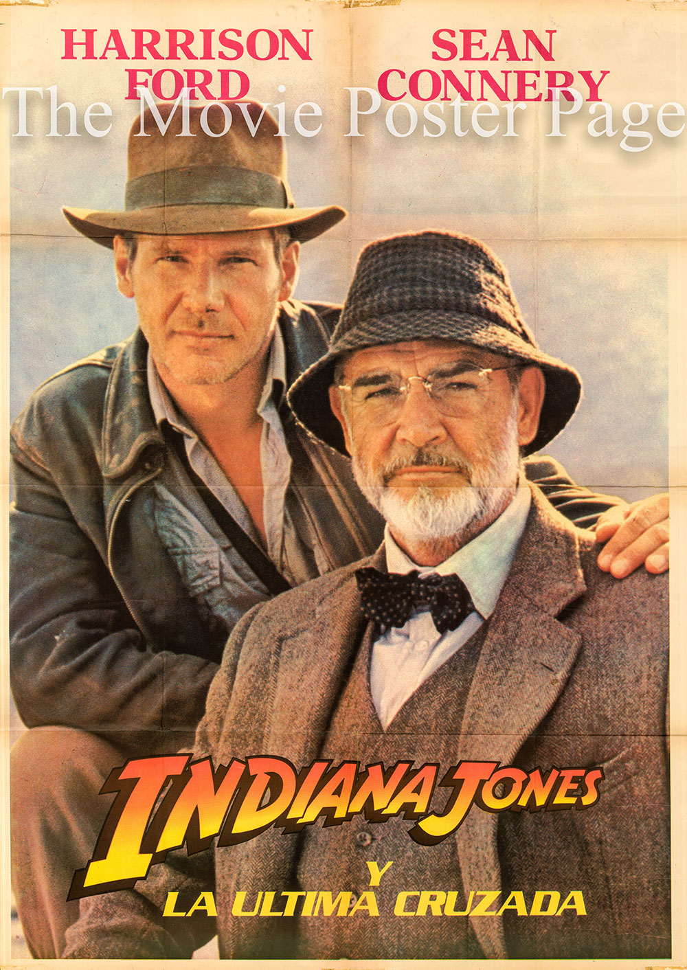 Pictured is a Spanish two-sheet poster for the 1989 Steven Spielberg film Indiana Jones and the Last Crusade starring Harrison Ford as Indiana Jones.