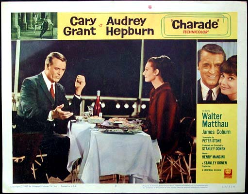 Pictured is a US lobby card for the 1963 Stanley Donen film Charade starring Audrey Hepburn and Cary Grant.