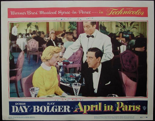 Pictured is a US lobby card for the 1953 David Butler film April in Paris starring Doris Day and Ray Bolger.