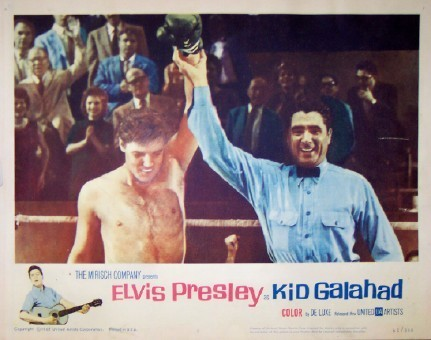 Pictured is a US lobby card for the 1962 Phil Karlson film Kid Galahad starring Elvis Presley.