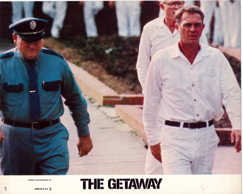 Pictured is an 8x10 promotional color lobby card for the 1975 Sam Peckinpah film The Getaway starring Steve McQueen and Ali McGraw.