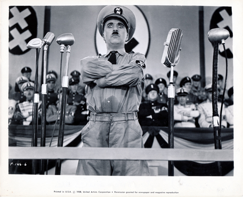 Pictured is a US promotional still photo from a 1958 rerelease of the 1940 Charles Chaplin film The Great Dictator starring Charlie Chaplin.