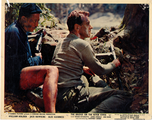 Pictured is a US promotional still photo from the 1957 David Lean film The Bridge on the River Kwai starring William Holden.