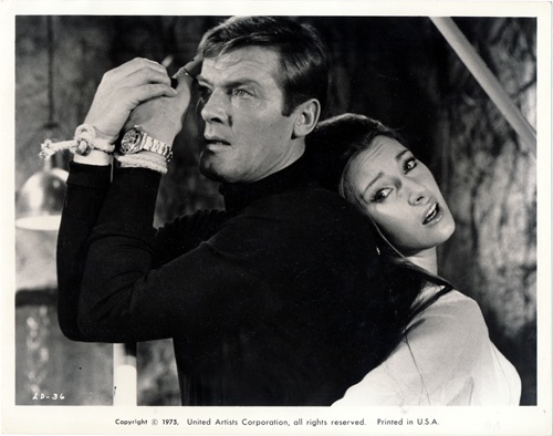 Pictured is a US promotional still photo from a 1975 rerelease of the 1973 Guy Hamilton film Live and Let Die starring Roger Moore.