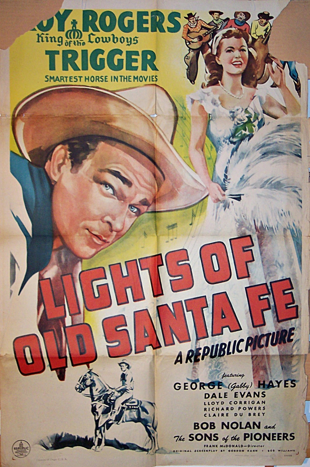 Pictured is a US one-sheet promotional poster for the 1944 Frank McDonald film Lights of Old Santa Fe starring Roy Rogers.