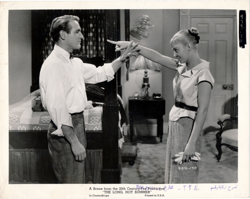 Pictured is a US promotional still photo from the 1958 Martin Ritt film The Long, Hot Summer starring Paul Newman and Joanne Woodward based on stories by William Faulkner.